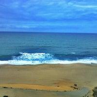 Photo taken at Praia das Bicas by Pedro F. on 9/25/2012
