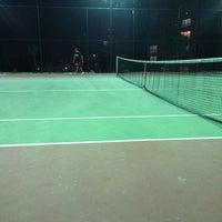 Photo taken at Innovia Tennis Court by Özcan P. on 10/28/2013