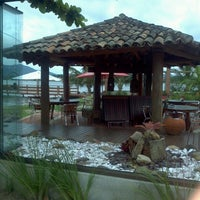 Photo taken at Ponta das Caranhas by Ariana T. on 3/6/2013