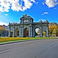 Photo taken at Alcalá Gate by Bryant B. on 12/9/2012