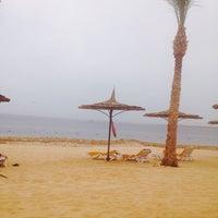 Photo taken at Beach at Reef Oasis Blue Bay Resort by Игорь П. on 5/5/2014