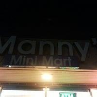 Photo taken at Mannys Mini Mart by Sasikumar G. on 9/10/2013