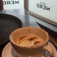 Photo taken at Caffè Nero by Tunc E. on 9/10/2013