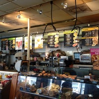 Photo taken at Einstein Bros Bagels by Santiago P. on 5/11/2013