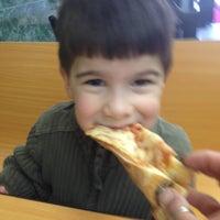 Photo taken at Knapp St Pizza by Vanessa P. on 4/10/2014
