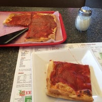 Photo taken at Joe Santucci's Square Pizza Bar and Grill by Lauren E. on 4/12/2014