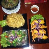 Photo taken at Rumah Thai Restaurant by Abby I. on 12/7/2014