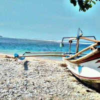 Photo taken at Pantai Ujung Genteng by Delvi C. on 11/16/2012
