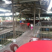 Photo taken at Floating Seafood Paradise by Julian O. on 9/7/2013