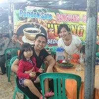 Photo taken at Pondok Sate Danguang-Danguang Asli by Dipo L. on 12/26/2014