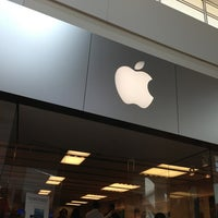 Photo taken at Apple Florida Mall by Isadora O. on 1/11/2013