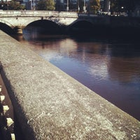 Photo taken at The River Liffey by Victor C. on 10/12/2012