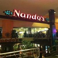 Photo taken at Nando's by Amaleez👻 on 1/25/2014