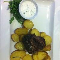 Photo taken at Uno Mediterranean Restaurant & Bar by Petra A. on 10/27/2012
