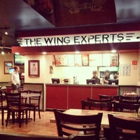 Photo taken at Wingstop by Mariana V. on 12/14/2012