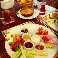 Photo taken at Symbol Cafe & Restaurant by seren c. on 4/21/2013