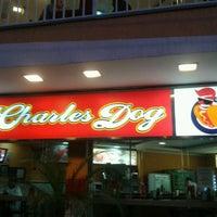 Photo taken at Charles Dog's by Christian Yukio N. on 11/19/2012