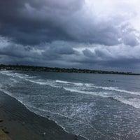 Photo taken at First Beach by Mackenzie on 10/14/2012