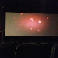 Photo taken at Bow Tie Cinemas Warner Quad by Drew D. on 5/7/2013