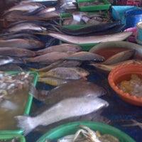 Photo taken at TPI (Tempat Pelelangan Ikan) by J L. on 9/5/2015