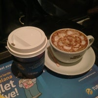 Photo taken at Caffé Nero by Elif on 12/16/2012