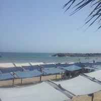 Photo taken at Playa Marina Grande by Henry G. on 7/25/2013