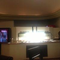 Photo taken at 24 hr Lounge by Jose L. on 7/24/2013