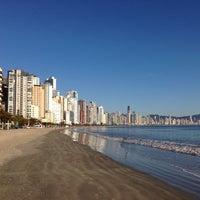 Photo taken at Praia Central de Balneário Camboriú by Vinicius F. on 7/29/2013