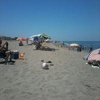 Photo taken at Akkum Plajı by Ümit Y. on 6/23/2013