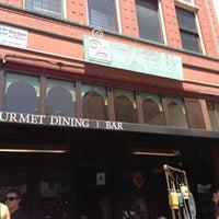 Photo taken at Cafe 21 by Katrina M. on 5/27/2013