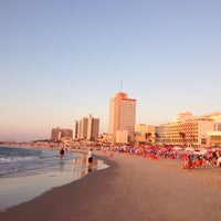 Photo taken at Frishman Beach by Dimitris E. on 10/14/2012