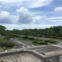 Photo taken at Uminonakamichi Seaside Park by Yas N. on 7/2/2017