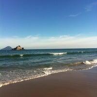 Photo taken at Praia de Juquehy by Irene A. on 7/6/2013