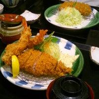 Photo taken at かつ雅 小幡店 by Shinya S. on 2/1/2013