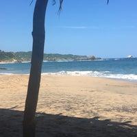 Photo taken at Playa Mazunte by Marce L. on 6/25/2018
