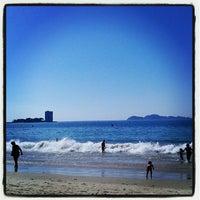Photo taken at Praia de Samil by Campe P. on 9/19/2012