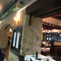 Photo taken at Romano's Macaroni Grill by Kyle M. on 2/28/2013