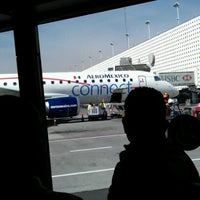 Photo taken at Sala/Gate 75 by Willy S. on 12/22/2012