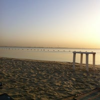 Photo taken at Al Nakheel Beach by Sara on 9/14/2012