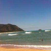 Photo taken at Praia de Grumari by Marcus Adriano on 10/2/2012