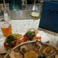 Photo taken at High Tide Seafood Bar & Grill by Beer Girl S. on 1/24/2017