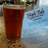 Photo taken at High Tide Seafood Bar & Grill by Beer Girl S. on 8/10/2014
