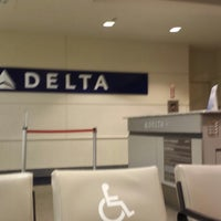 Photo taken at Gate A7 by Andy T. on 6/28/2014