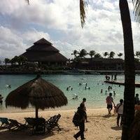 Photo taken at Playa Xcaret by Manuel S. on 12/27/2012