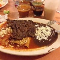 Photo taken at Los Faroles by Fernando C. on 1/25/2014