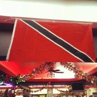 Photo taken at Singh's Roti Shop by Michael N. on 11/26/2012