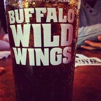Photo taken at Buffalo Wild Wings by Türker K. on 1/18/2013
