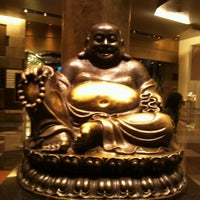 Photo taken at Big Buddah Statue at ARIA by Angela L. on 12/8/2012