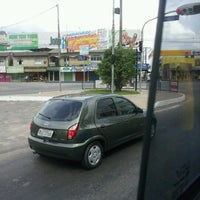 Photo taken at Avenida Arterial 18 by Rayanne O. on 10/17/2012