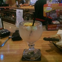 Photo taken at Applebee's Neighborhood Grill & Bar by Craig W. on 7/4/2014
